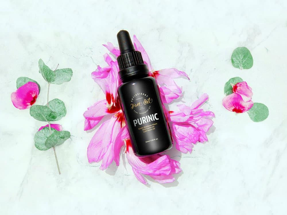 Free Cosmetic Oil Bottle PSD Mockup