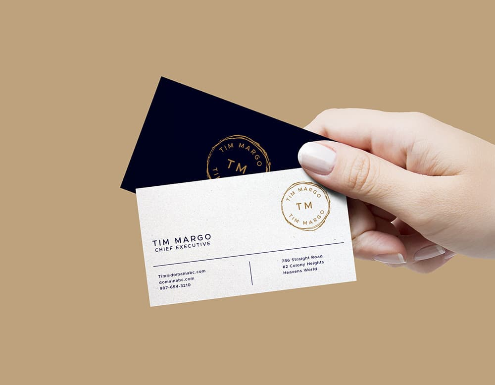 Free Hand Holding Business Card PSD Mockup