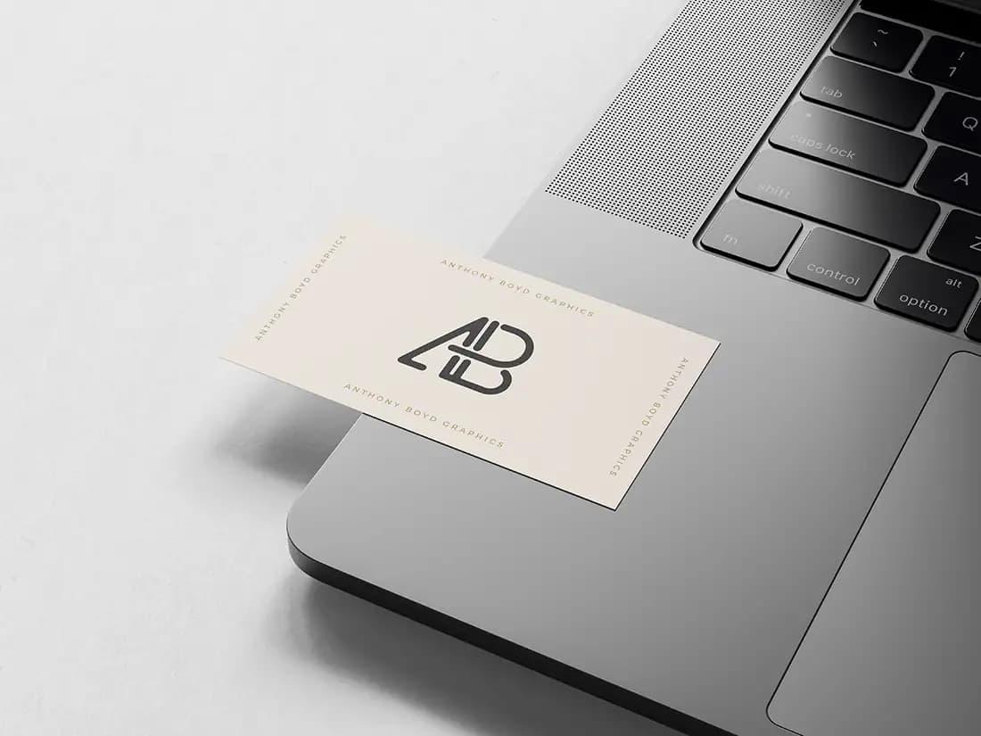 Free Business Card on MacBook PSD Mockup
