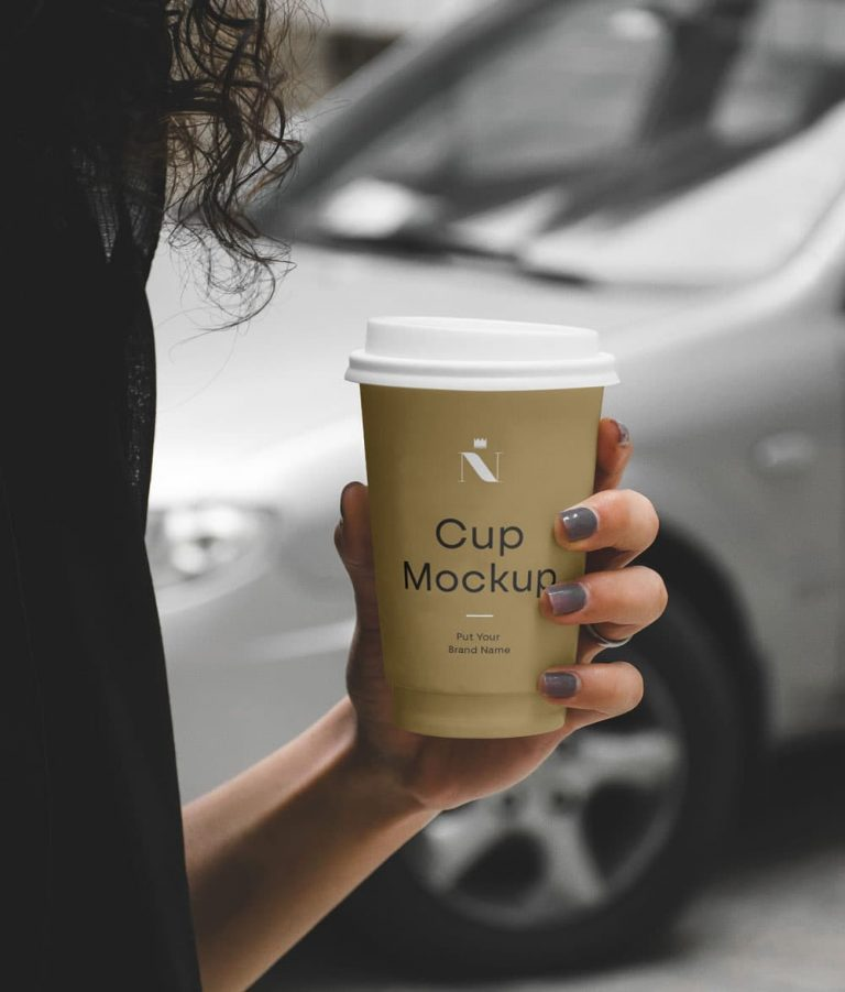 Free Woman Holding Cup PSD Mockup